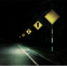 Five warning signs on a dark road